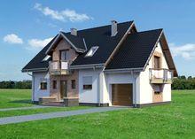 Большой загородный дом с элегантным эркером и красивыми балконами