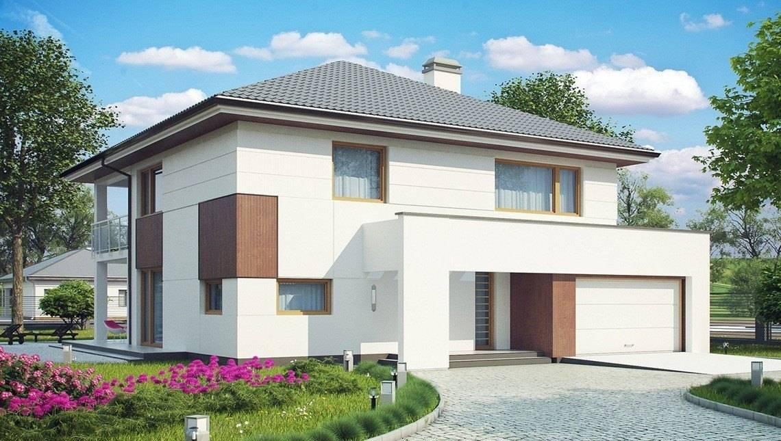 Проект 2х этажного коттеджа со сдвоенным гаражом
