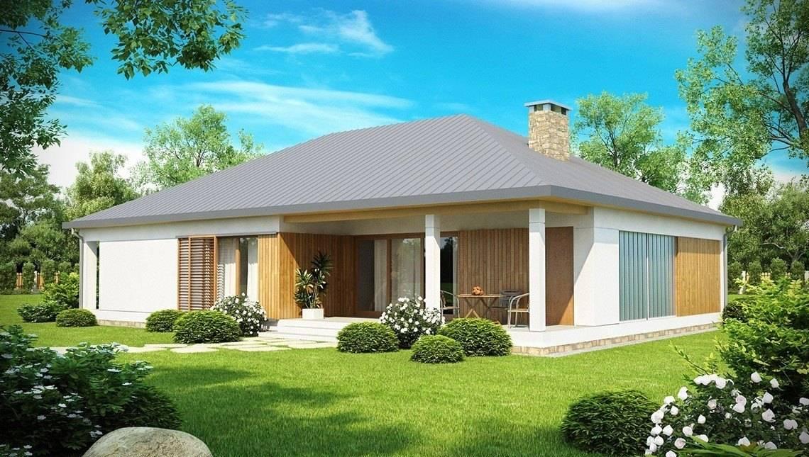 Проект уютного дома с гаражом и крытой террасой
