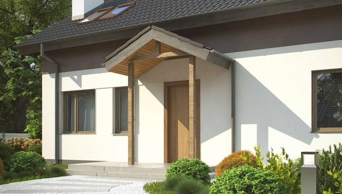 Компактный дачный дом с угловым окном в кухне