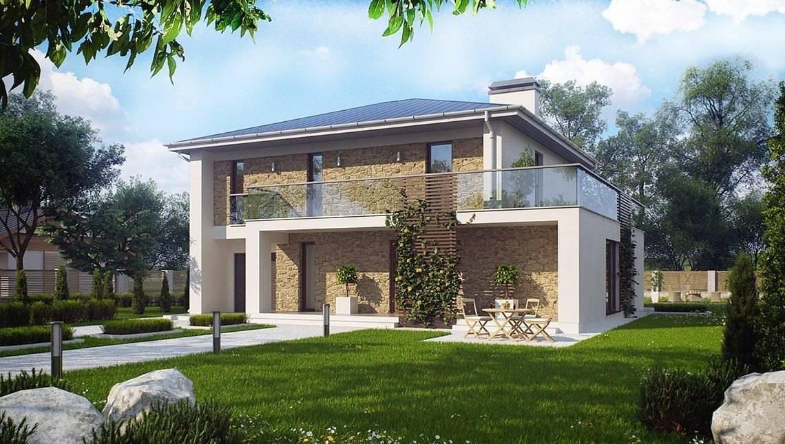 Двухэтажный дом с большими окнами