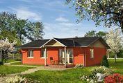 Проект уютного дома до 100 m² с террасой и четырьмя спальнями